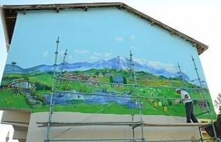 Günyüzü'nün tarihi mekanları otel duvarına...